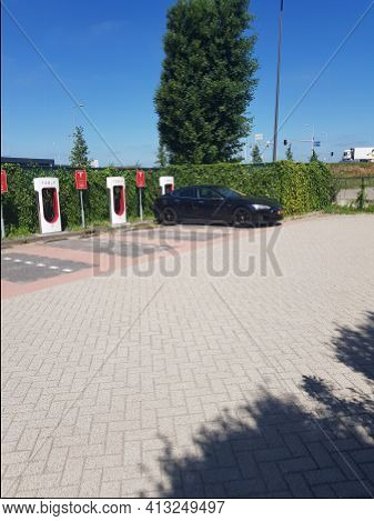 Venlo, Holland - June 28, 2019:  Electric Car Model Tesla S 75d In The Netherlands At A Tesla Chargi
