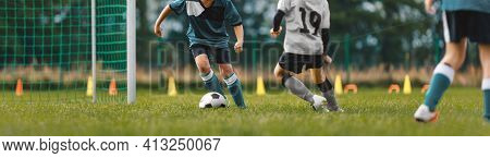 Soccer Players On Training Pitch. Group Of Young Footballers In A Duel. Soccer Kids Running Ball In