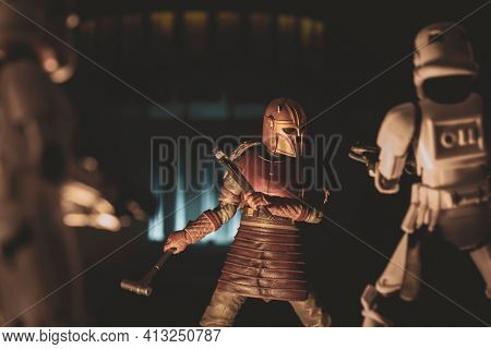 MARCH 8 2021: Star Wars Mandalorian Armorer in her secret foundry workshop battling Imperial Stormtroopers - Hasbro action figure