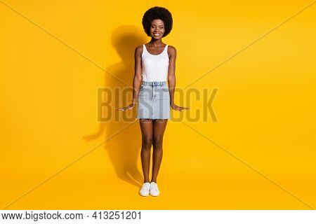 Full Length Body Size View Of Lovely Cheerful Skinny Wavy-haired Lady Posing Isolated Over Bright Ye