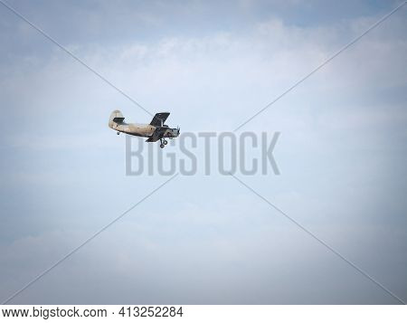 Old Retro Plane, A  Vintage Biplane With Turbopropellers, Flying, Small, With A Blue Sky Sunny Backg