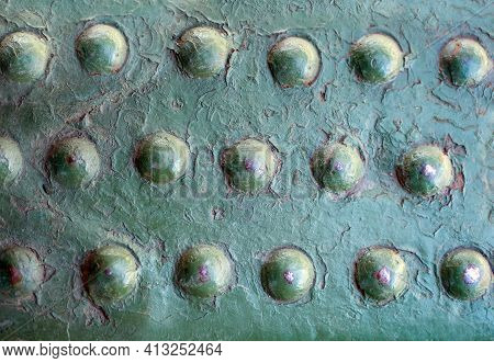 Old Military Relief Texture  Bodywork With Large Rivets Of The Green Color On Board The Armoured Mil
