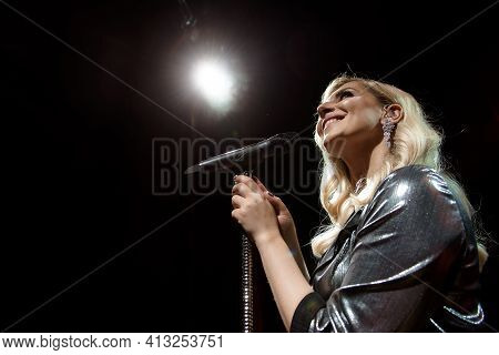 Singer And Microphone. Singer Woman On Stage.