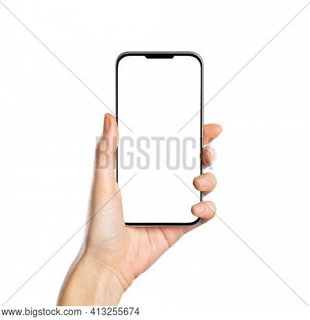 Woman hand holding smartphone with white screen isolated on white background. Close up of hands of young woman holding cellphone with empty screen. Hand showing phone with blank space for your own app