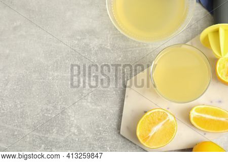 Freshly Squeezed Lemon Juice On Grey Marble Table, Flat Lay. Space For Text