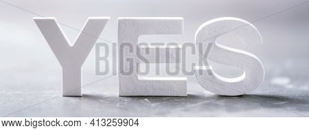 Word Yes Made With Cement Letters On Grey Marble Background. Copy Space. Strong Business Concept
