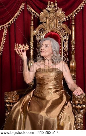 Portrait Of Beautiful Senior Queen On Throne