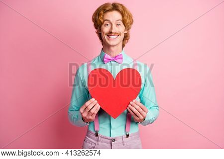 Photo Of Young Happy Positive Good Mood Cheerful Funky Gentleman Hold Big Red Heart Isolated On Pink