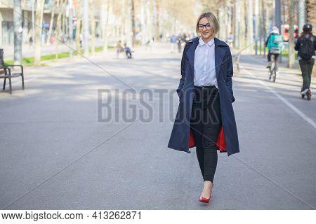 Smiling Female Entrepreneur Walking Outside After Work.