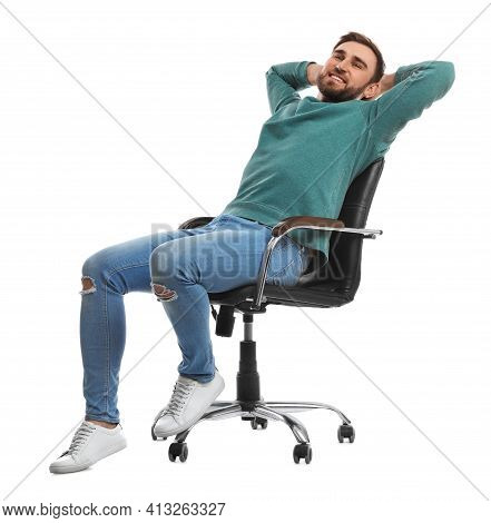 Young Man Relaxing In Comfortable Office Chair On White Background