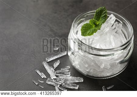Menthol Crystals And Mint Leaves On Grey Background, Closeup. Space For Text