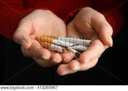 Woman With Cigarettes On Black Background, Closeup. Quitting Smoking Concept