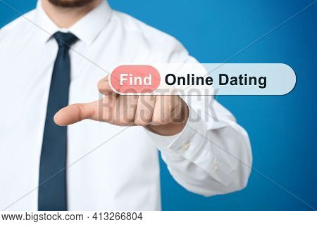 Man Pointing At Search Bar With Request Online Dating On Blue Background, Closeup
