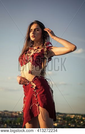 Esotericism And Occultism. Wild And Dangerous. Spiritual Development. Woman Wear Leather Clothes Sky