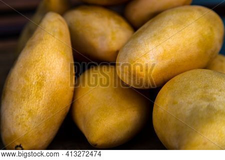 Ripe Yellow Barracuda Mango Fruit (nam Dok Mai) On The Old Wooden Table Background. Tropical Healthy