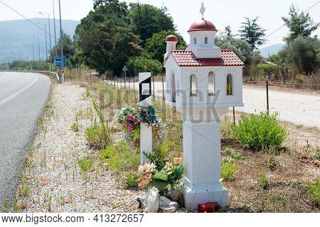 Miniature shrine with red roof alongside roads around Igoumenitsa, Greece   called kandilakia
