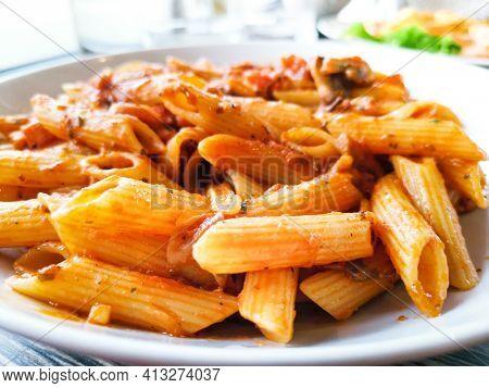Tasty pasta, Italian tomato sauce pasta on the table