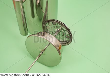 Filter Grid On A Cap Of Stainless Steel Tea Pot On Light Green Background. French-press. Coffee. Bre