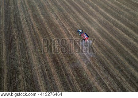 Tractor Rides On The Field And Makes Inorganic Fertilizers