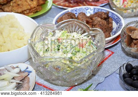 Crystal Vase With Olivier Salad On The Background Of Other Goodies.