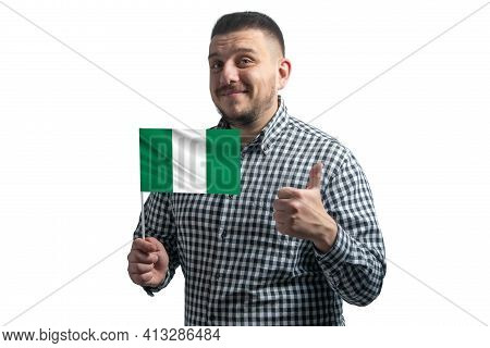 White Guy Holding A Flag Of Nigeria And Shows The Class By Hand Isolated On A White Background. Like
