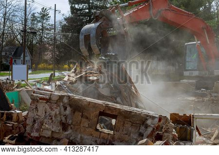 Excavator Demolishing Of The House After The Hurricane Urban Regeneration Broken House After Tragedy