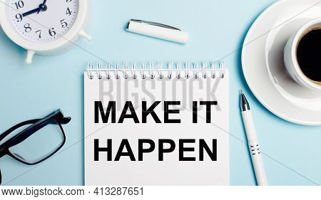 On A Light Blue Background, A White Cup With Coffee, A White Alarm Clock, A White Pen And A Notebook