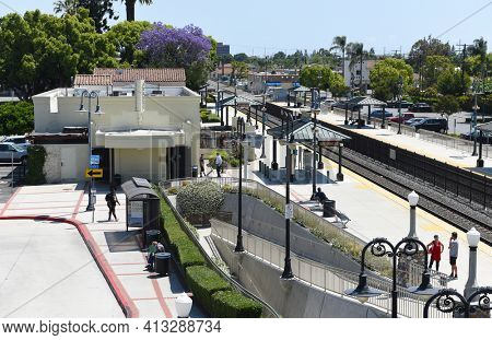 ORANGE, CALIFORNIA - 14 MAY 2020: The Orange Transportation Center is an intermodal transit station serving Metrolink trains as well as Orange County Transportation Authority buses.