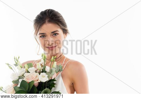 Happy Fiancee Smiling At Camera While Holding Wedding Bouquet Isolated On White.