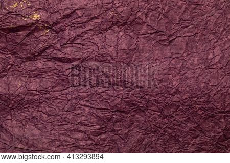 The Background Is Made Of Crumpled Paper In The Color Of Burgundy Wine With Gold Paint.