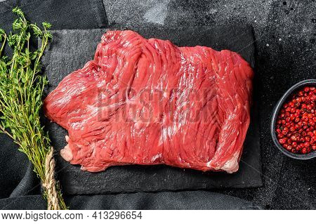Raw Flank Steak, Marbled Meat. Black Background. Top View. Copy Space