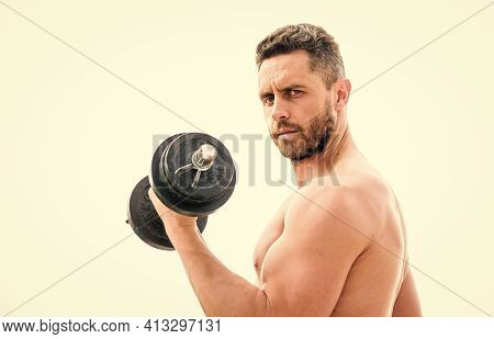 Man Sportsman With Strong Hands. Steroids. Fitness And Sport. Muscular Man Exercising In Morning Wit
