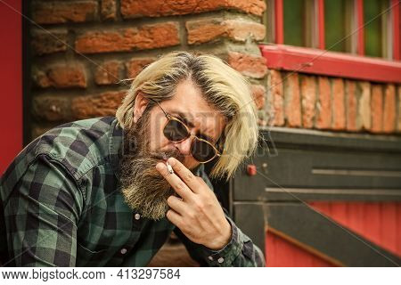 Start New Day. Secondhand Or Passive Smoke. Brutal Caucasian Male In Glasses. Man Smoking Outdoor. F