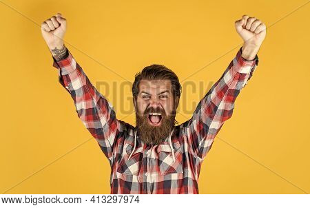 Catch The Success. Brutal Happy Man With Beard Standing Indoor. Young And Brutal. Confident And Hand
