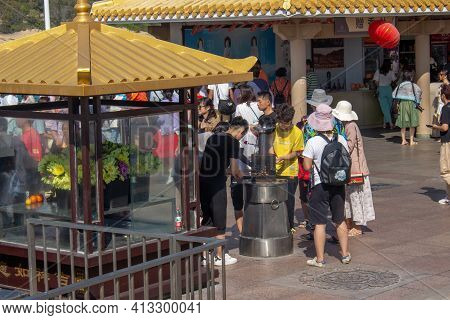 China, Hainan Island, Sanya - January 21, 2020: Believers Set Fire To Incense As A Gift To The For B