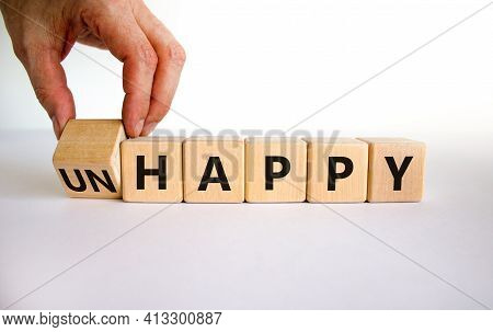 Be Happy, Do Not Unhappy Symbol. Businessman Turns The Wooden Cube And Changes The Word 'unhappy' To