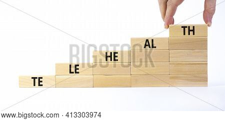 Telehealth Symbol. Wooden Blocks With Word 'telehealth' Stacking As Step Stair On Beautiful White Ba