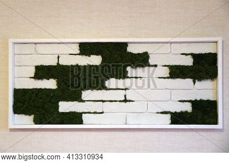 Panel Of Stabilized Moss Between White Bricks On The Wall