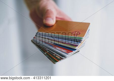A Man Is Hand Holds A Stack Of Discount Cards. Discount Card With 15% Discount.