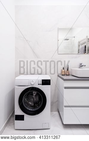 Vertical View Of Bathroom With Automatic Washing Machine, Modern Interior Design, Mirror Over Sink A