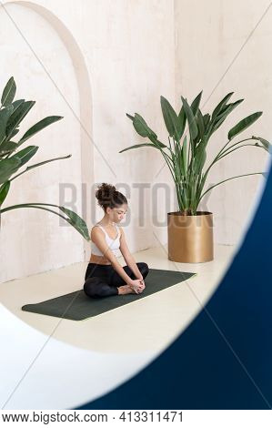 Advertising Concept. Vertical View Of Calm Afro American Woman In Sportswear Sitting On Fitness Mat,