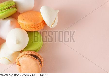 Macaroons, Beige, Peach, Green French Macaroons, White Bizet On Beige Background Top View