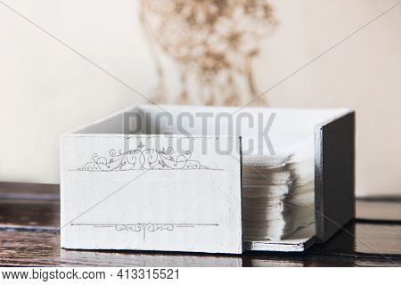 White Napkin Holder For Paper Napkins In The Interior. With Place For Text