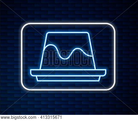 Glowing Neon Line Pudding Custard With Caramel Glaze Icon Isolated On Brick Wall Background. Vector