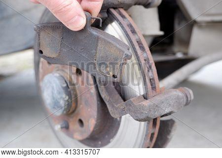 Car Repair. Replacing The Brake Pads Of Disc Brakes. Brake Disc Close-up.