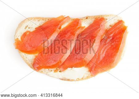 Sandwiches with smoked trout on white surface shot from above