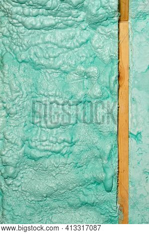 Texture And Background Of A Wall Made Of Ecological Light Green Construction Foam, Laid In Parallel