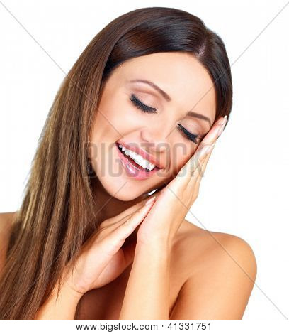 Beautiful laughing woman pretending to sleep resting her head on her hands with her eyes closed isolated on white