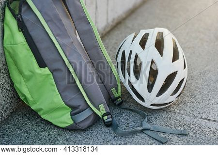 Close Up Of Backpack And White Hemet On Granite Surface