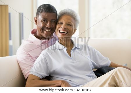Couples Relaxing In Living Room And Smiling